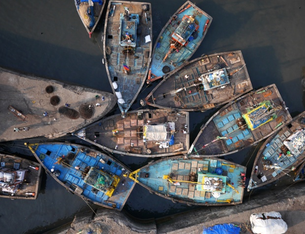 A knot of fishing boats at the entrance to Sassoon Dock, Mumbai.